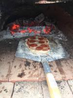 FEF sponsored construction of a pizza oven